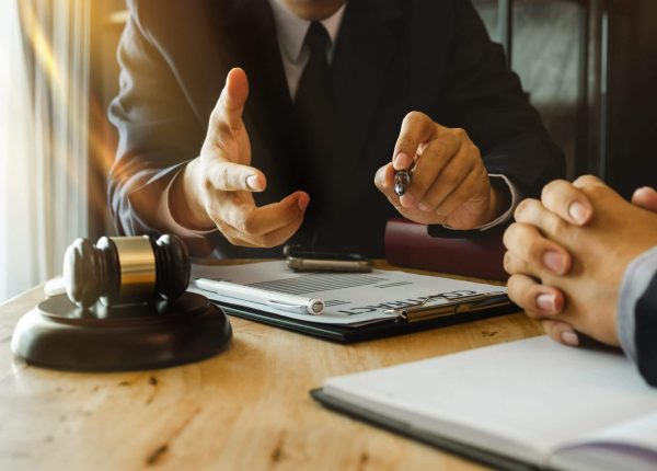 lawyer reviewing paperwork with client